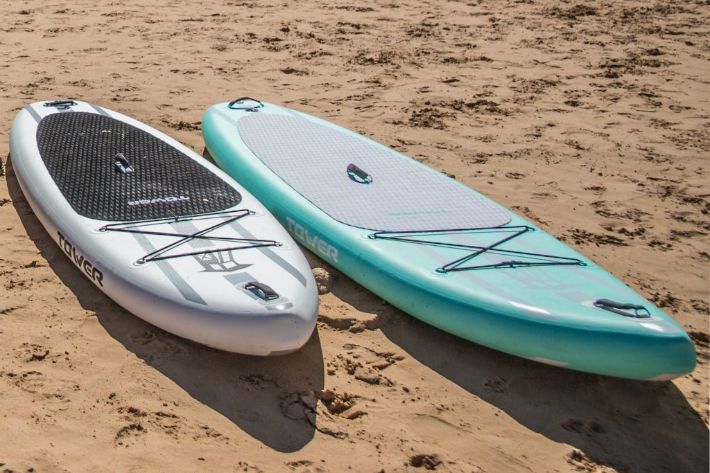 paddle boards on sandy beach