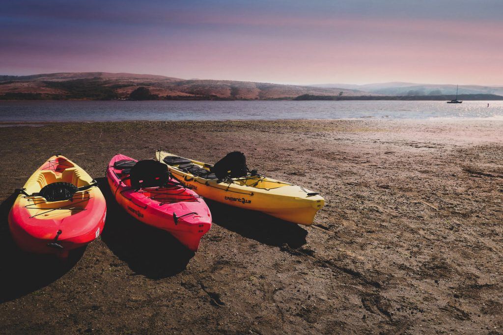 three kayaks on shore