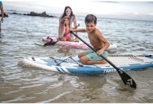 kids on stand up paddle boards